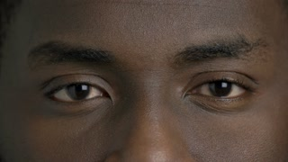Afro-american man closed eyes close up. Face of black man close up.