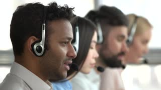 American black man working in tech support. Working indian operator face, side profile view.