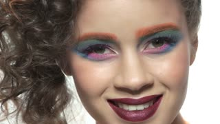 Artistic girl smiling. Happy female face, makeup.