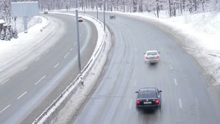 Auto road in winter. Winter traffic. Slippery winter road. Icing on the road. Dangerous road.