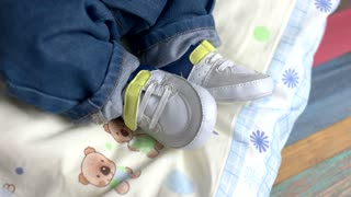 Baby wearing sneakers. Shoes of child close up. Buy footwear for kids online.