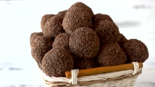 Basket of delicious ball-shaped sweets. Yummy chocolate truffles with rum and biscuit crumbs. Healthy homemade candies.