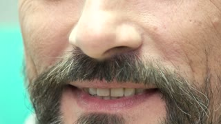 Bearded man smiling. Mouth of person close up. Perfect smile tips.