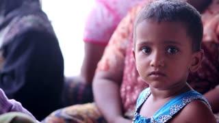 Beautiful child. Asian boy. Curious look of Myanmar boy.
