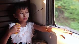 Beautiful girl eating corn in the train. Travel girl.