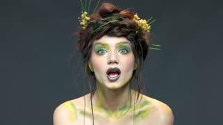 Beautiful girl sending air kiss. Happy woman, nature makeup art.