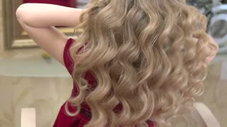 Beautiful hair of little girl. Wavy blonde hair. Golden rules of hair care.