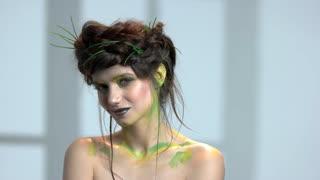 Beautiful nature themed makeup. Romantic young woman.