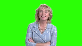 Beautiful woman is laughing on green screen. Gorgeous happy business woman on Alpha Channel background. Joyful mature female.