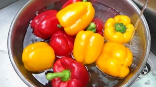 Bell peppers in water. Ripe bright-colored vegetable.