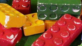 Big colorful constructor bricks. Colorful children's toys. Game lego constructor. Plastic building blocks.