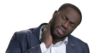 Black african man with bad neck pain, after long hours of work. Isolated white background. Negative human emotions, facial expressions.