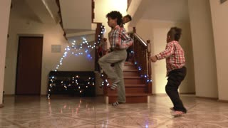 Black boys dancing on Christmas. Kids brake and disco dancing. True experts of style. Christmas joy and energy.