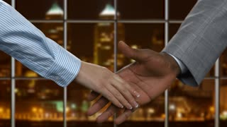Black businessman shaking female hand. Handshake of businesspeople at midnight. This city needs new government. Building ways towards success.