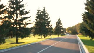 Blurred asphalt road and nature. Blurry outdoor background.