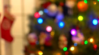 Blurred New Year tree with blinking lights. Abstract Christmas tree background. Happy New Year card.