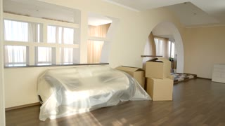 Boxes in the room. Modern flat interior. Low price apartments for rent.