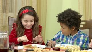 Boy and girl eating. Kids at the table. Nutrition recommendations for children.