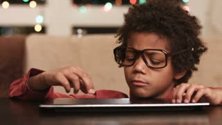 Boy typing on keyboard. Kid in glasses. Ask the internet. Little computer genius.