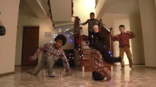 Boy's handstand during Christmas dance. Kids breakdancing on Christmas. Their artistry is infinite. Limitless energy of youth.