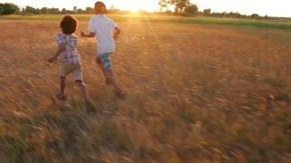 Boys run at sunset. Evening scamper. Sport children.