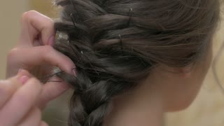 Braided hairdo close up. Female hair macro. French braid tutorial.