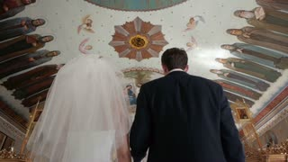 Bride and groom at the church during a wedding ceremony. Wedding ceremony at church. Happy bride and groom.