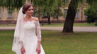 Bride in white dress makes a decision.