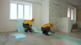 Builders insulated floor in a large house. Thermal insulation of the floor in the apartment.