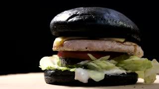 Rotating Burger On Black Background Stock Video Footage VideoBlocks - Black hamburger