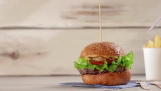 Burger with glass of cola. Hamburger menu on white table. Juicy burger and cool drink. Quick boost of energy.