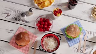 Burgers and brown grain bread. Mushrooms and bread on table. Tasty food on white table. Junk food or fresh bread.