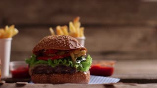 Burgers with sauce and fries. Fast food with tomato sauce. Delicious-looking food on table. Choose your favorite.