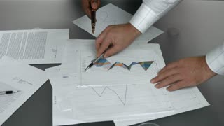 Business charts and hands. Papers with graphs.