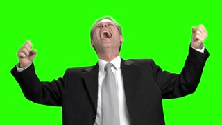 Business man heartily cheering with his mouth open. Successful businessman with raising hands yelling, green background.
