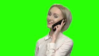 Business woman talking on her mobile phone. Portrait of cute positive happy caucasian woman talking with her husband on phone. Green screen hromakey background for keying.