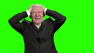 Businessman lost money, slow-motion. Bad investment or economic crisis old man in suit expressions, green hromakey background.