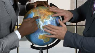 Businessmen touching globe. Two men in suits. Conflict of interests. Prove you're right.