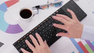 Businesswoman fast typing on keyboard. Secretary of fast typing on the computer and drinking coffee.