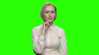 Businesswoman using invisible imaginary interface. Green screen hromakey background for keying.