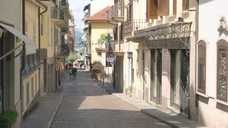 Car in the narrow street. Town, sunny day. Safe driving tips for travelers.