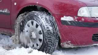 Car stuck in the snow. Snow element. Drivers can not get out of the snow. Paralyzed the movement of vehicles.