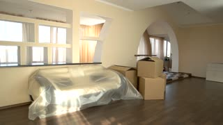 Cardboard boxes in the room. Interior of modern flat. How to rent an apartment.