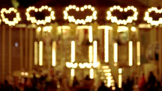 Carousel with lights shaped heart. Blurred carousel.