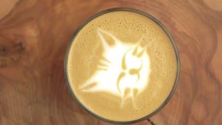Cat latte art. Close up of coffee foam.