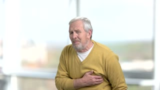 Caucasian aged man suffering from heart-attack. High blood pressure. How to prevent heart attack.