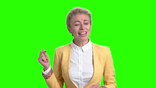 Charming lady is singing on green screen. Cute woman is singing and dancing on alpha channel background. Enjoy of music.