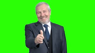 Cheerful confident businessman giving a thumb up. Happy elderly man in grey suit showing thumb up on Alpha Channel background.