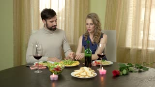 Cheerful couple eating grapes. Man and woman, romantic dinner. Why women love funny guys.
