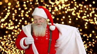 Cheerful Santa on lights background. Dancing Santa Claus.